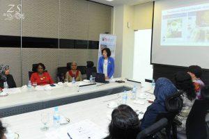 "Madam Woo Sow Pheng, President of the Johor Women's League (JEWEL) presenting an introduction to the ""Action For Our Children Campaign"" (Kempen Tindak Demi Anak Kita (TinDAK)) programme. [YBhg. Woo Sow Pheng (Pengerusi Pertubuhan Pergerakan Wanita Johor (JEWEL) mempersembahkan pengenalan mengenai program""Kempen Tindak Demi Anak Kita (TinDAK)""]"